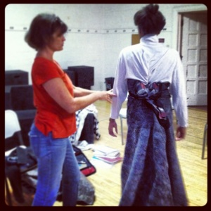 Steph Schroyer improvising a Victorian gown on her model, Amaka.