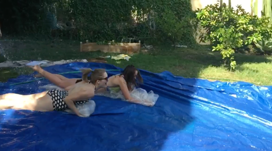 Dani and I engaging in a little bit of competitive Slip-n-Slide drag racing. NBD.